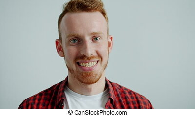 Portrait of attractive guy in casual clothing smiling ...