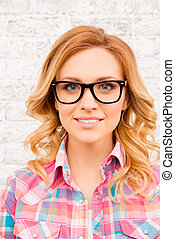 Portrait of attractive happy smiling blonde woman in spectacles