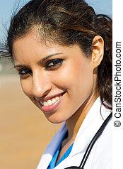 attractive indian nurse outdoors