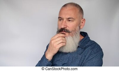 Portrait of attractive middle aged bearded Caucasian man ...