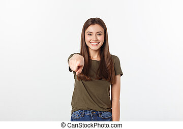 portrait of attractive smile laugh teenage girl, pointing her finger, wear green shirt, white teeth, brown long hair, isolated over white background.