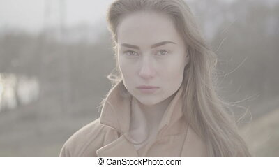 Portrait of Attractive Smiling Caucasian Ethnicity Woman in Urban Environment. shallow depth of field