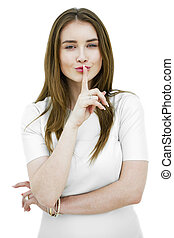 Portrait of attractive teenage girl with finger on lips