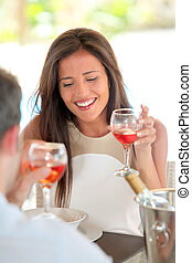 Portrait of attractive woman drinking wine in restaurant