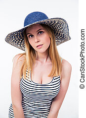 Portrait of attractive woman in hat