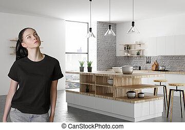Portrait of attractive woman in kitchen
