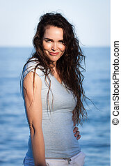 Portrait of attractive woman on beach