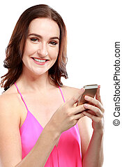 attractive woman smiling while holding a mobilephone