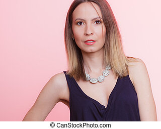 Portrait of attractive woman with necklace