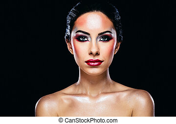 Portrait of attractive woman with skin care on black background