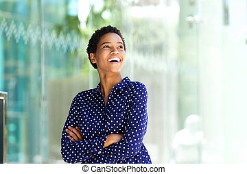 attractive young african american business woman laughing