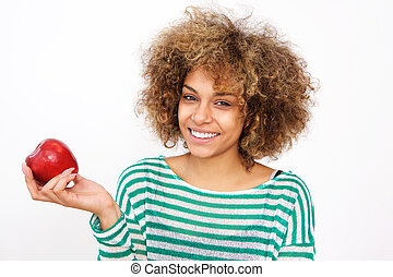 attractive young african american woman holding an apple