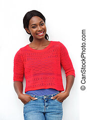 attractive young african american woman smiling against white background