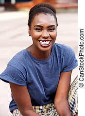 Portrait of attractive young african american woman smiling