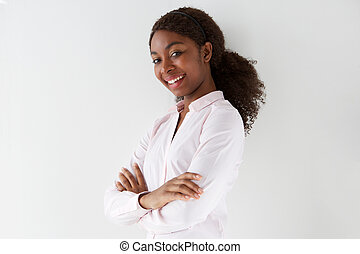 attractive young african american woman smiling with arms crossed on white background