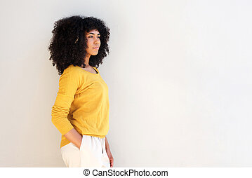 attractive young african american woman standing against white background