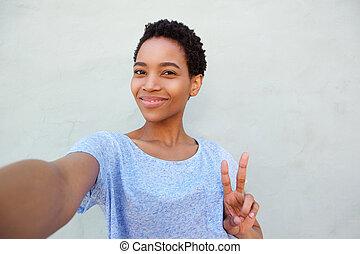 attractive young african american woman taking selfie