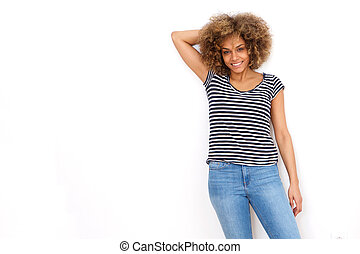 attractive young african woman smiling in striped shirt against white background