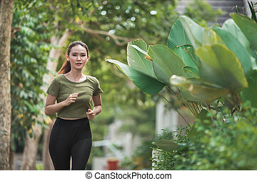 asian woman running and exercising outdoor