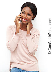 attractive young black woman talking ion cellphone against isolated white background