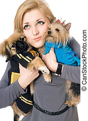 Portrait of attractive young blonde with two dogs. Isolated