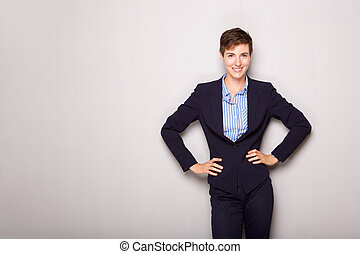 attractive young business woman smiling against white background