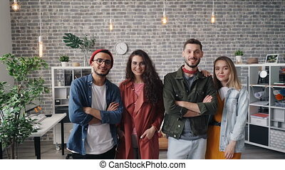 Portrait of attractive young people business team standing in office smiling