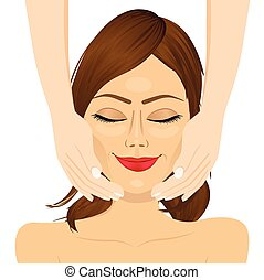 attractive young woman enjoying facial massage beauty therapy