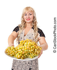 Portrait of attractive young woman holding bowl of grapes