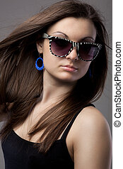 Portrait of attractive young woman in glasses