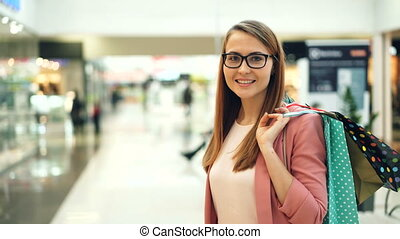Portrait of attractive young woman wearing glasses and...
