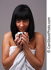 young woman with a coffee cup