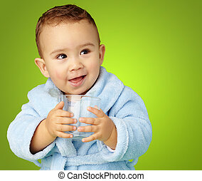 Portrait Of Baby Boy Holding A Glass