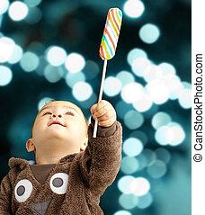 Portrait Of Baby Boy Holding Lollipop