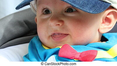 Portrait Of Baby Boy With Brown Eyes Drooling And Smiling