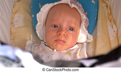 Portrait of baby girl in stroller