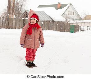 girl in winter village