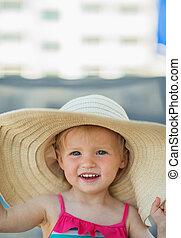Portrait of baby in beach hat