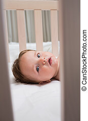 Portrait of baby in crib