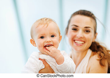 Portrait of baby playing with mother