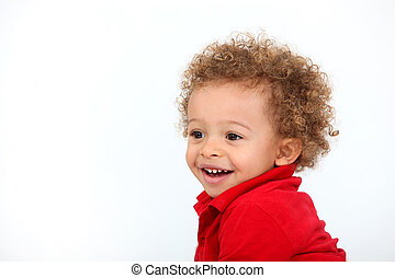 Portrait of baby with curly hair