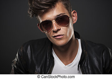 Portrait of bad boy wearing glasses