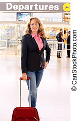 Portrait of beautiful 35 years old woman standing in airport