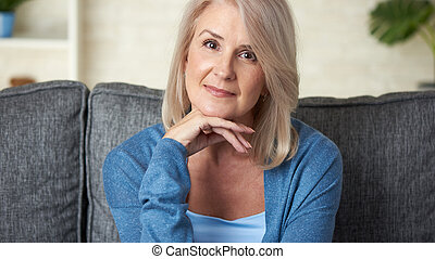 Portrait of beautiful 50 year old blond woman