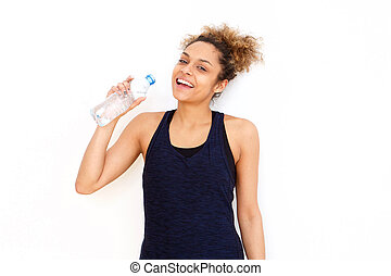 beautiful african american girl drinking water from bottle