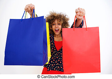 beautiful african american girl happy with shopping bags