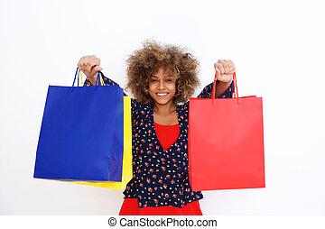 beautiful african american girl holding shopping bags