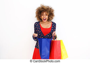 beautiful african american girl looking surprised with shopping bags