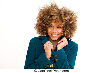 beautiful african american girl smiling with winter coat against white background