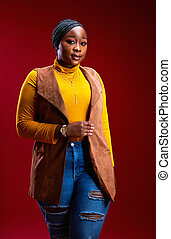 portrait of beautiful african american woman in stylish outfit